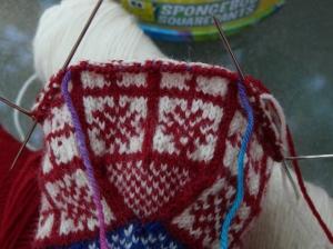 thumb stitches on waste yarn